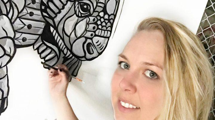 Rachel Painting AXE Mural